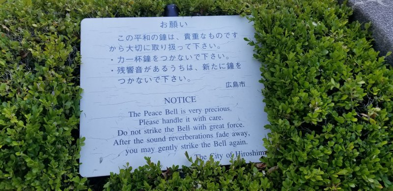 A plaque at the base of the Peace Bell.